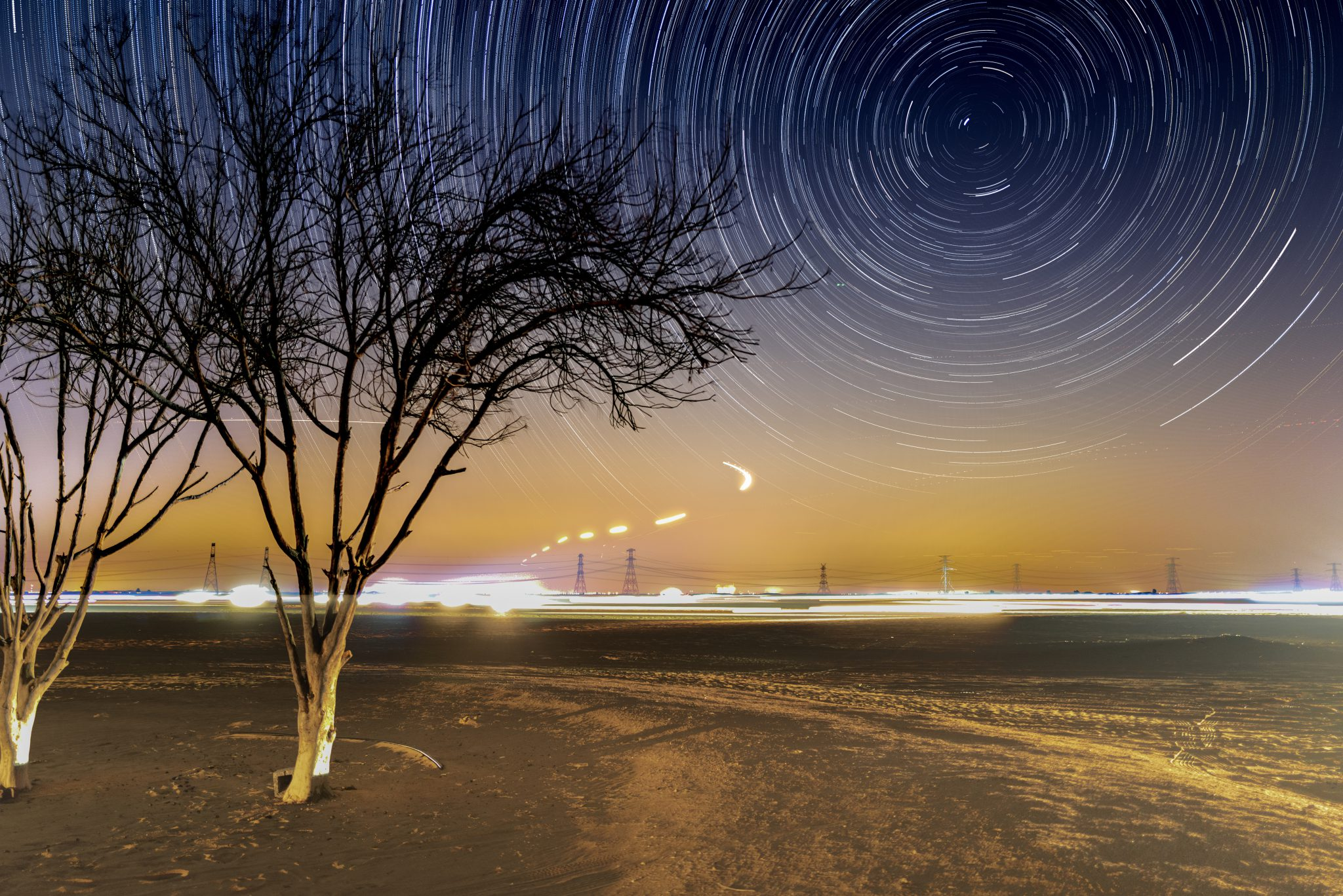 Composite photograph of star trails taken from the Al Qudra Desert on the outskirts of Dubai